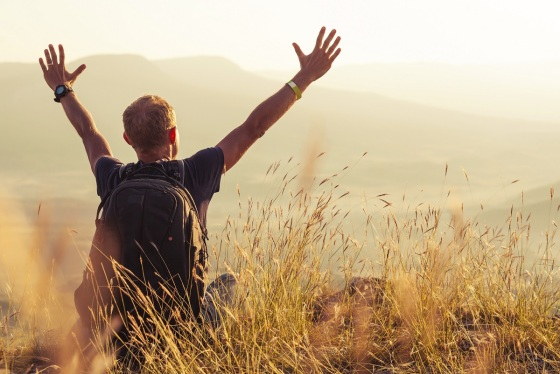 Man greeting golden rising of the sun
