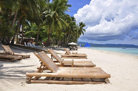 Beach chairs on perfect tropical white sand beach in Boracay