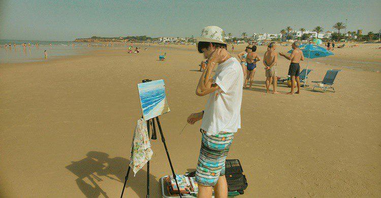Pintor en la playa de La Barrosa. Eleazar (Flickr)